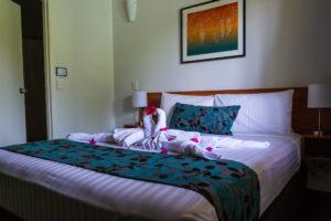 Palm City Resort - Zimmer mit Bett